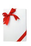 Rectangular shape white gift box. Decorated with red bow ribbon Royalty Free Stock Image