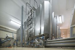 Rectangular steel tank. The system of storage and pumping of liquid Stock Photo