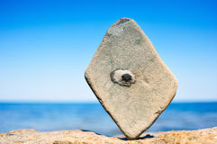 Rectangular Stone. In balance on the seacoast Stock Photos
