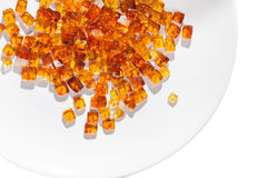Rectangular stones yellow amber. On a white plate Stock Image