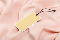 Rectangular Tag on a clothes. fashion, people and shopping concept - close up tag of clothing item. Rectangular Tag on a clothes. fashion, people and shopping stock photo