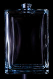 Rectangular transparent bottle of cologne isolated on a black background.  Royalty Free Stock Photo