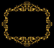 Rectangular vignette frame made of golden leaves and petals on a black base. Baroque elements  scrolls,rich gold gradients Royalty Free Stock Image