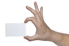 Rectangular white sheet held in the fingers, copy space Stock Images