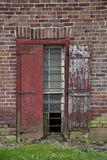 Rectangular windown on aging, rustic brick wall. Stock Photography