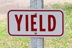 A rectangular yield word sign.  stock image