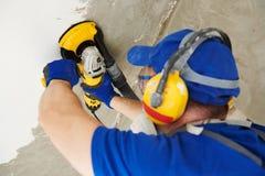 Rectification superficielle de plafond concret par la machine de broyeur d'angle image libre de droits