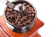 Rectifieuse de café et grains de café Photographie stock
