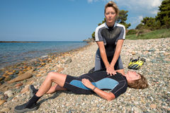 Recue training. First aid training for female Scuba divers royalty free stock images