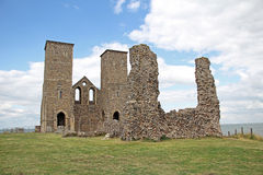 Reculver ancient roman castle fort. Photo of ancient roman reculver fort castle ruins showing weather erosion by cliff edge Royalty Free Stock Image