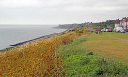 Reculver coastline. Photo of reculver coastline showing ancient roman twin fort towers in the distance Stock Photos
