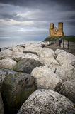 Reculver Towers at Dusk. Reculver Towers at the end of the day, with boulders in the foreground Stock Images
