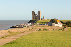 Reculver Towers, Reculver, Kent, UK. Reculver Towers,  Reculver, Kent, UK view from the cliff top walk heading to the towers on the on the coast near to Herne Royalty Free Stock Images