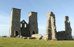 Reculver towers roman saxon shore fort and remains of 12th century church. Reculver towers roman saxon shore fort and remains of 12th century church undercut by Royalty Free Stock Photo