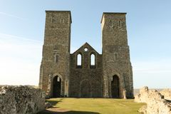 Reculver towers roman saxon shore fort and remains of 12th century church. Reculver towers roman saxon shore fort and remains of 12th century church undercut by Stock Photos