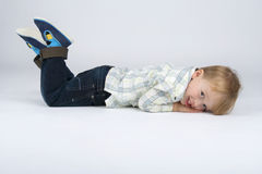 Recumbent boy. Royalty Free Stock Photos