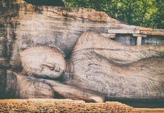 Recumbent Buddha statue at The Gal Vihara. Panorama royalty free stock photo