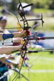 Recurve bow archery competition hand only. vertical Royalty Free Stock Images