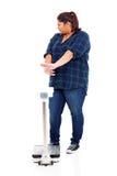 Escala excesso de peso da recusa da mulher imagem de stock