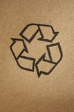 Recyclable. Universal symbol printed on brown cardboard Royalty Free Stock Image