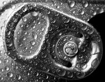 Recyclable. Extreme macro of droplets on soda can lock with inscription RECYCLABLE. Shallow DOF Royalty Free Stock Image