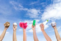 Recyclable hand hold show symbol plastic bottle used paper canned light bulb. A sky background Stock Photos