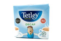 Recyclable Paper based Container or packet of Tetley Decaf Tea. Largs, SCotland, UK - April 25, 2018: Recyclable Paper based Container or packet of Tetley Decaf royalty free stock photography
