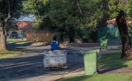 Recyclable products collected from household refuse bins. Johannesburg, South Africa - unidentified jobless man uses a makeshift trolley to collect recyclable stock photo