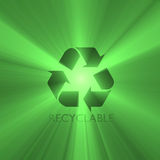 Recyclable sign green light flare Royalty Free Stock Image