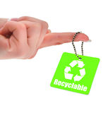Recyclable symbol. Hand holding green tag with recyclable symbol Royalty Free Stock Photos