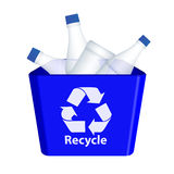 Recycle. Waste bottles in blue colored recycling container on isolated background Stock Photography