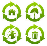 Recycle. Four green recycle icons isolated on white Royalty Free Stock Photo
