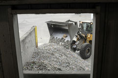 Recycle. A front end loader moves pieces of metal for recycling at a Florida landfill Stock Photo