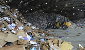 Recycle. A front end loader moves waste materials at a Florida landfill getting ready to be recycled Stock Images