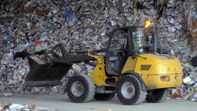 Recycle. A front end loader moves waste material at a Florida landfill getting it ready to be recycled Stock Photo