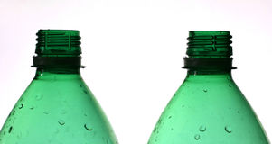 Recycle. Two green plastic bottles, shallow DOF, focus on the top of the bottles stock photos
