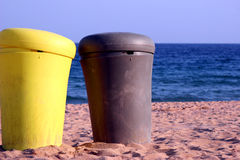 Recycle. Two boxes in the beach Royalty Free Stock Photos