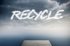 Recycle against cloudy sky over ocean Royalty Free Stock Photography