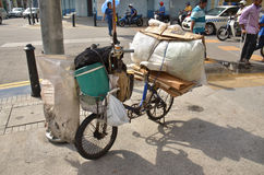 Recycle bike. Full of recyclable materiel the owner clears the streets of Georgetown, Malaysia Royalty Free Stock Photo