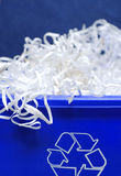 Recycle bin. Blue recycle bin with shredded paper spilling out Stock Photography
