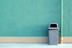 A recycle bin. Sitting against a green wall royalty free stock photo