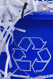 Recycle bin. Shredded paper spilling out of blue recycle bin Stock Photo