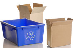 Recycle bin and cardboard boxes Royalty Free Stock Photos