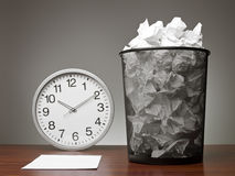 Recycle Bin and a clock Royalty Free Stock Images