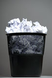 Recycle bin filled with crumpled papers Stock Photography