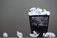 Recycle bin filled with crumpled papers Stock Images