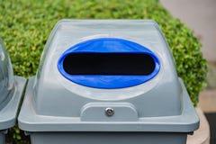 Recycle bin in garden Royalty Free Stock Image