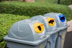 Recycle bin in garden Stock Photos