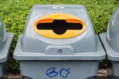 Recycle bin in garden Stock Images