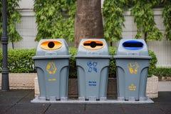 Recycle bin in garden Stock Image